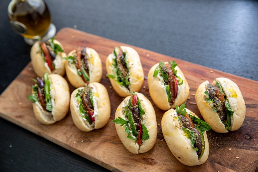 mini labneh rolls served on a wooden board