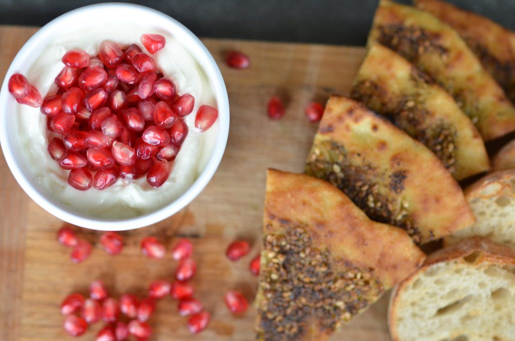 pomegranate Labneh served with zaatar herb pizzas