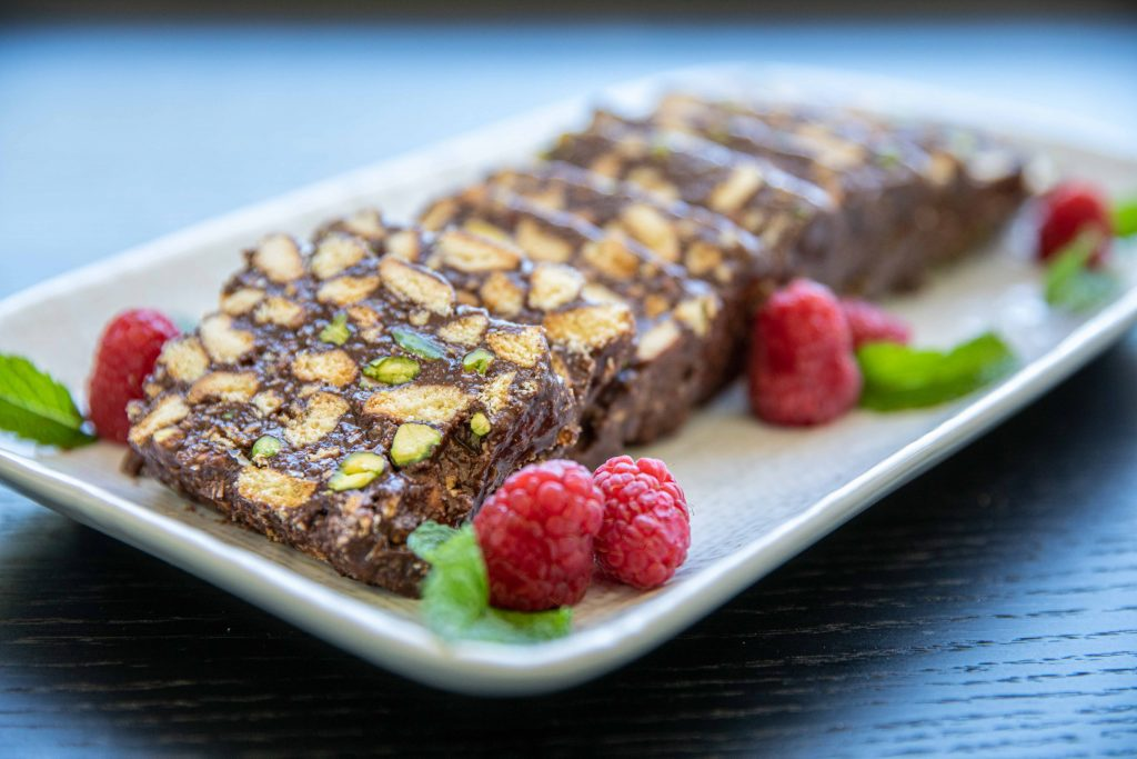 pistachio and coconut chocolate log served in a platter