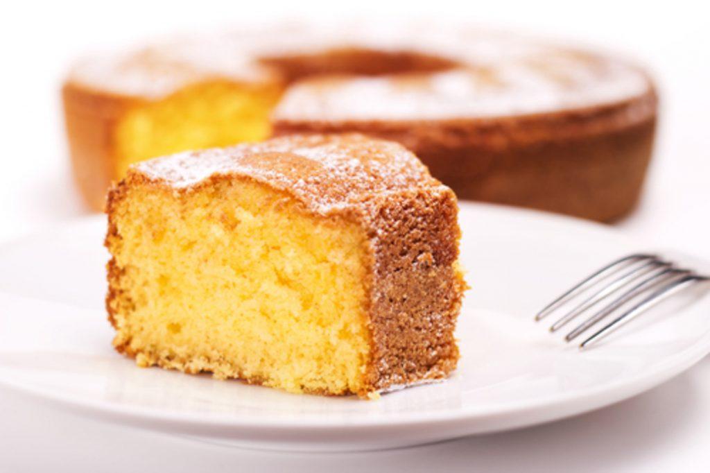 a slice of orange tea cake served on a plate