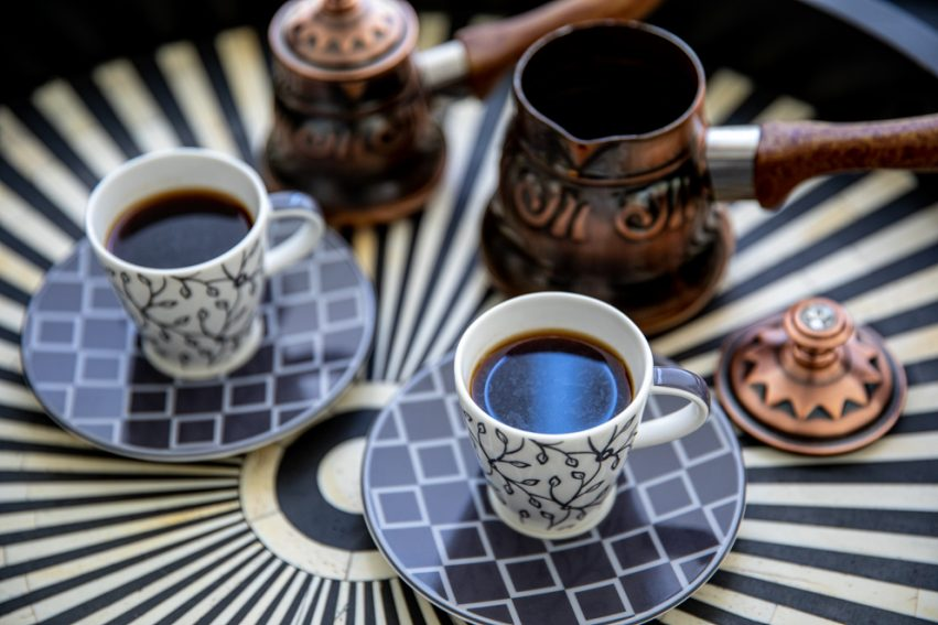 arabic coffee served on a wooden tray