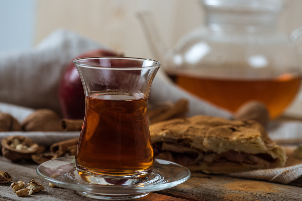 cinnamon tea in a traditional Arabic glass with no handles