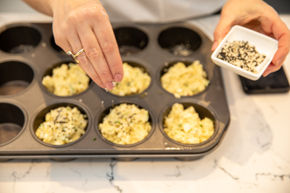 uncooked cheese muffins in a muffin tray