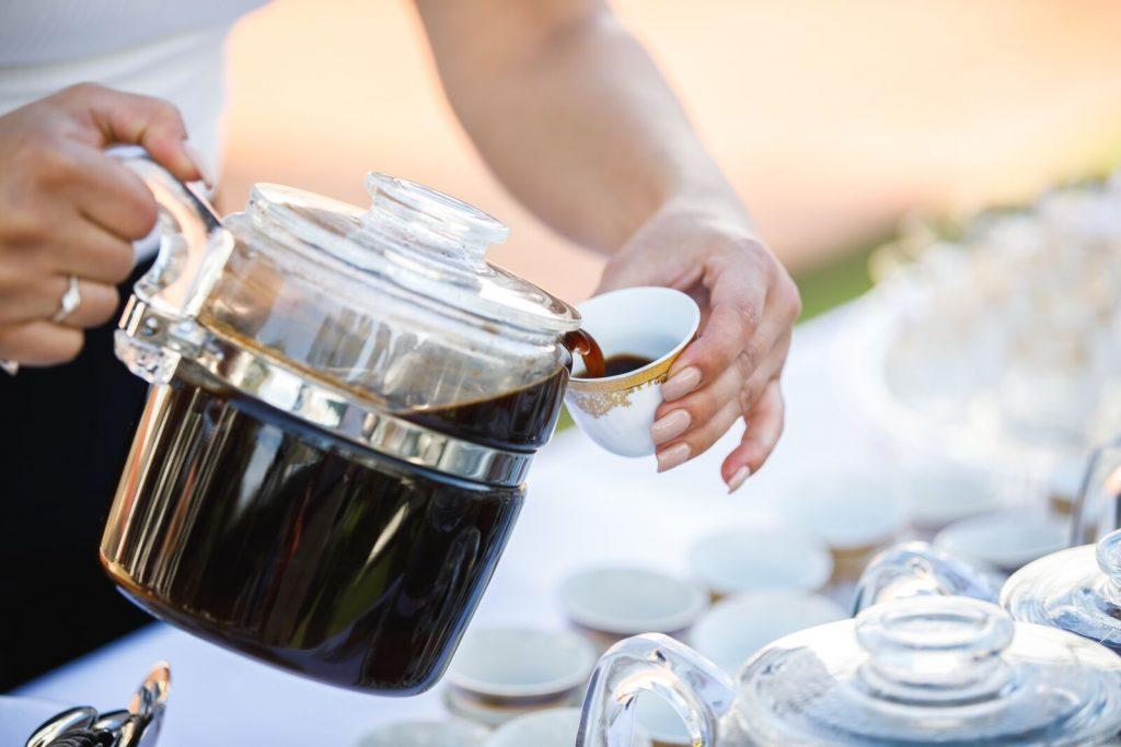 A lady serving Arabic coffee