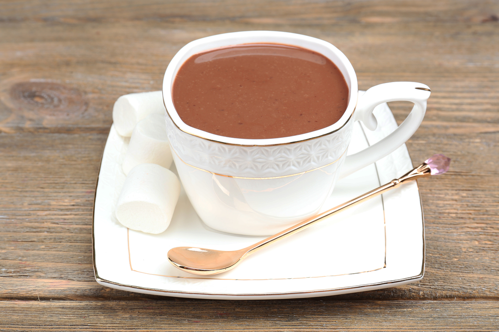 Cup of hot chocolate on table