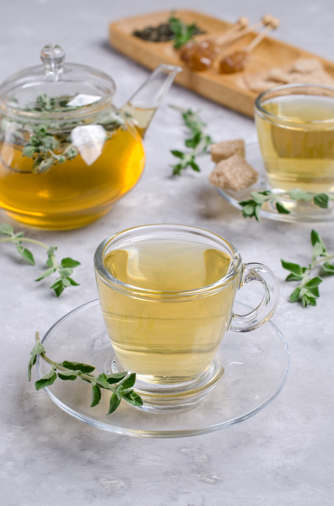 Marjoram tea in a pot and glasses