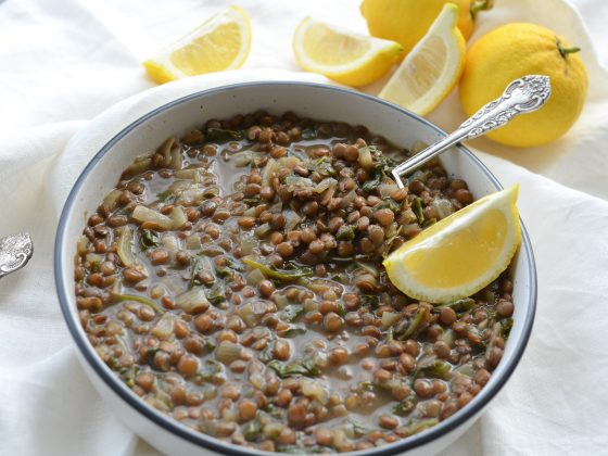 lentil and spinach soup served in a bowl