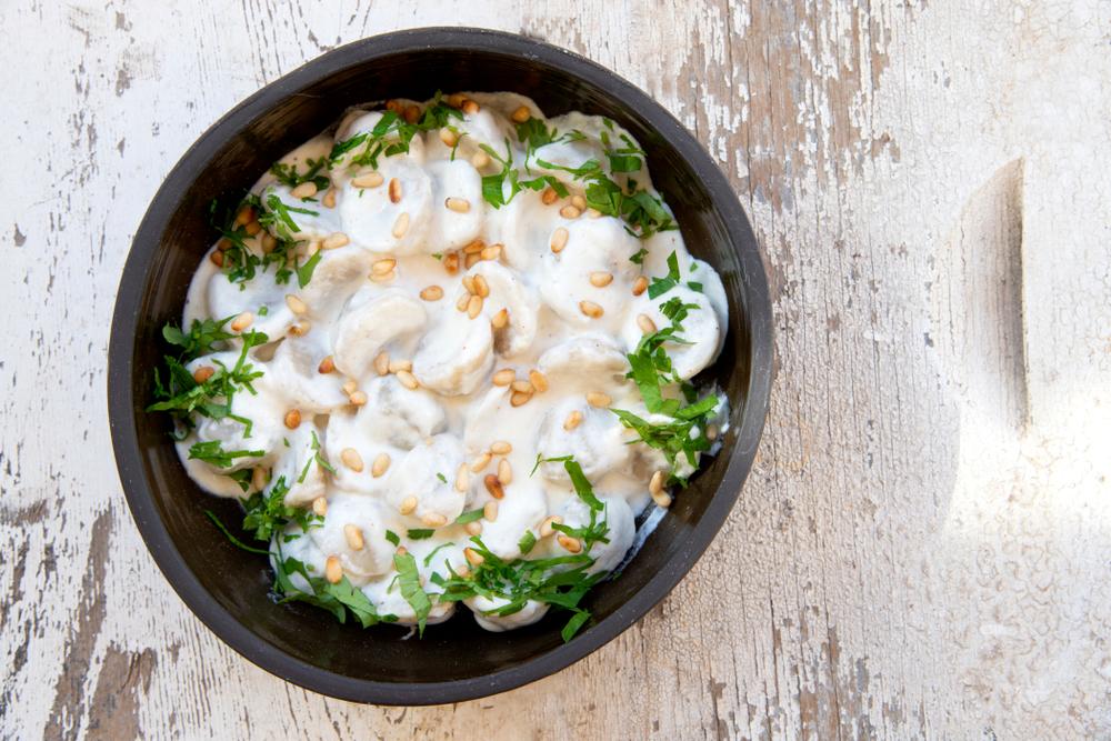 Shishbarak- lamb dumplings yogurt stew served in a bowl