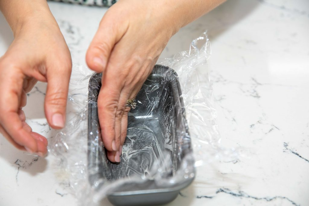 lining tin with plastic wrap