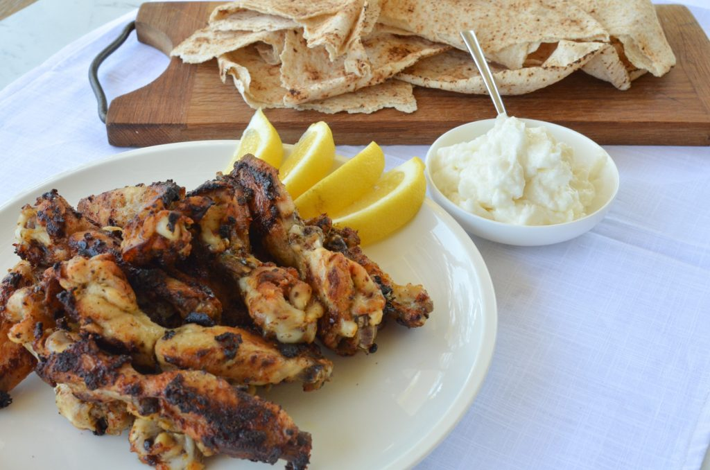 barbecued chicken wings served with garlic paste