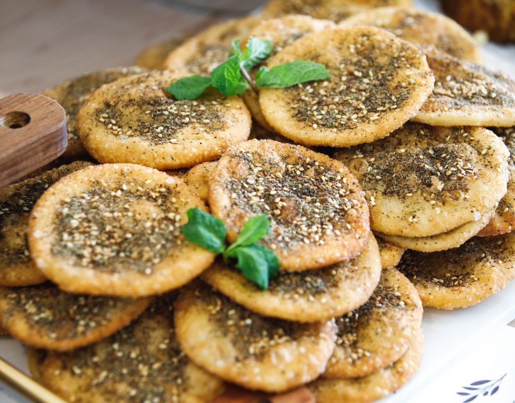 mini za'atar man-oushi served on a wooden board-WEB-001