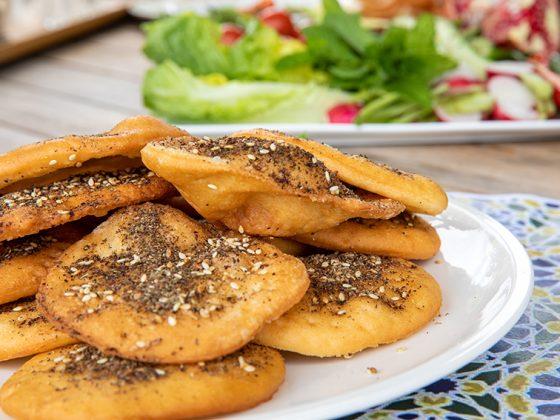 mini za'atar manoushi served with fresh vegetables