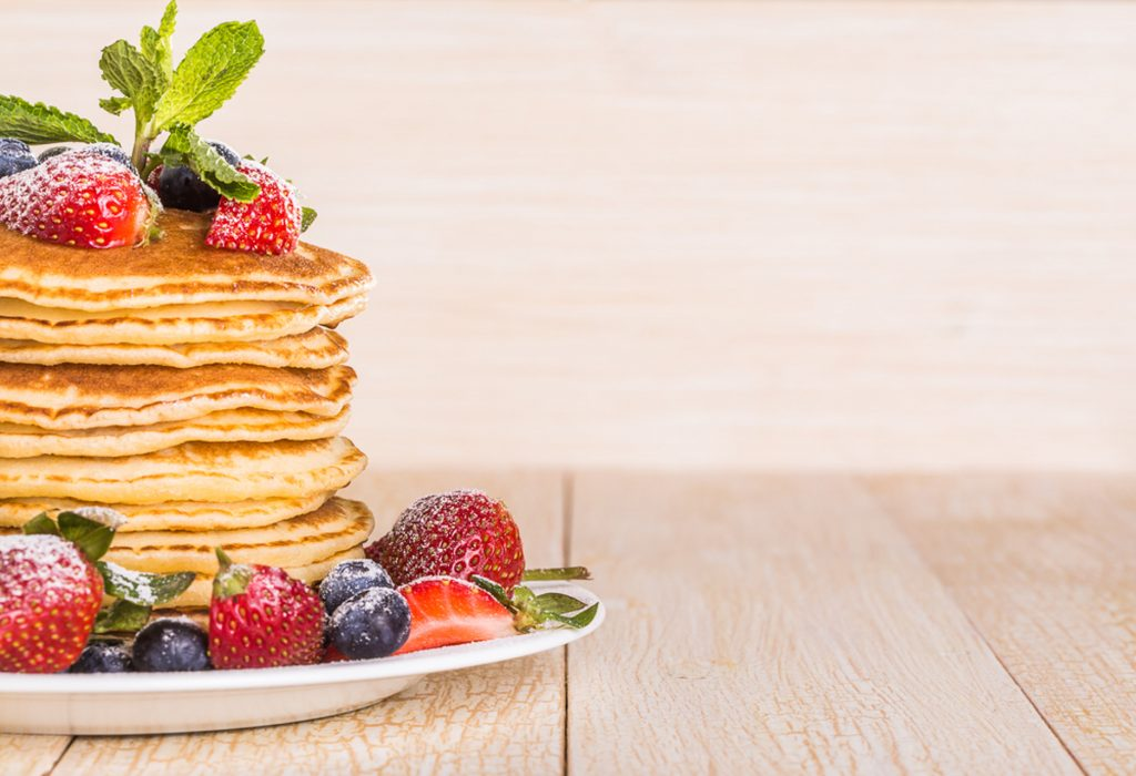 simple homemade pancakes with berries on top