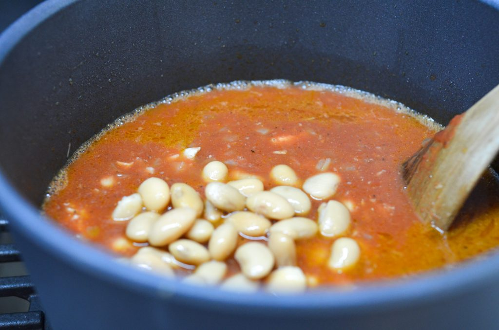 Adding white beans to the stew