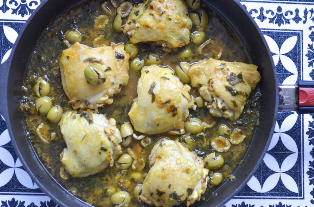 green olives and saffron chicken tagine in a frying pan