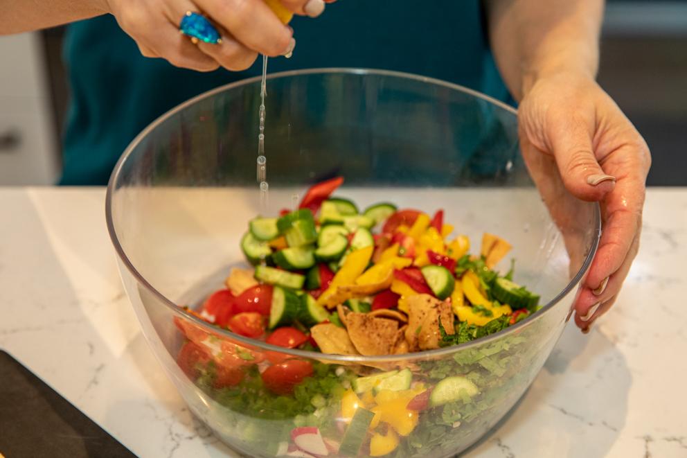 combining salad ingredients - Roasted Chickpea and Hummus salad
