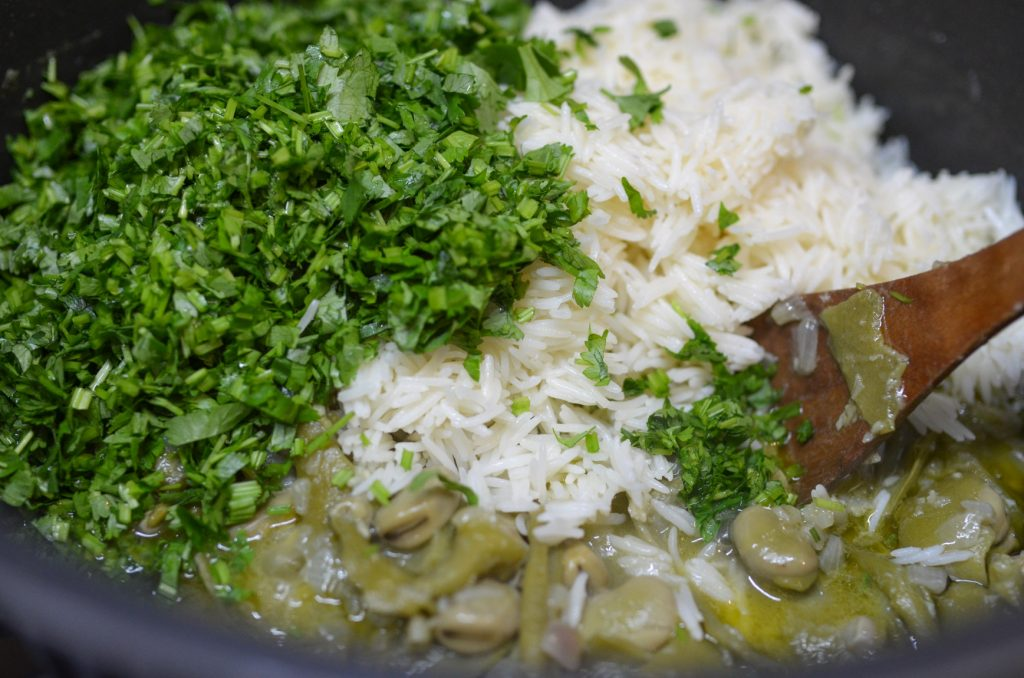 adding cooked rice and coriander to the broad-beans mixture