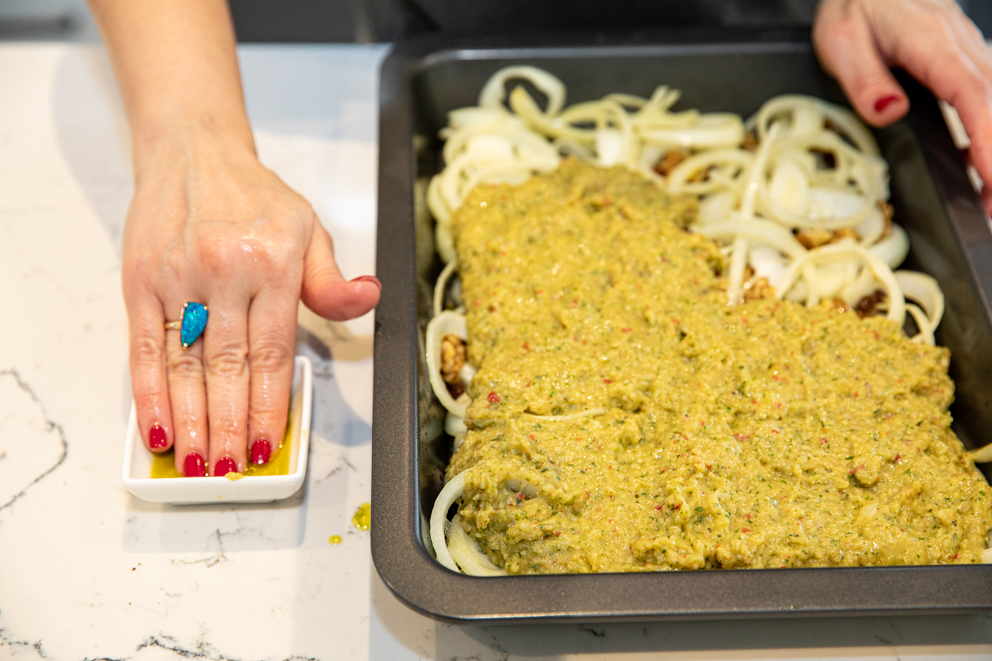 Placing the potato bake over the onion mixture