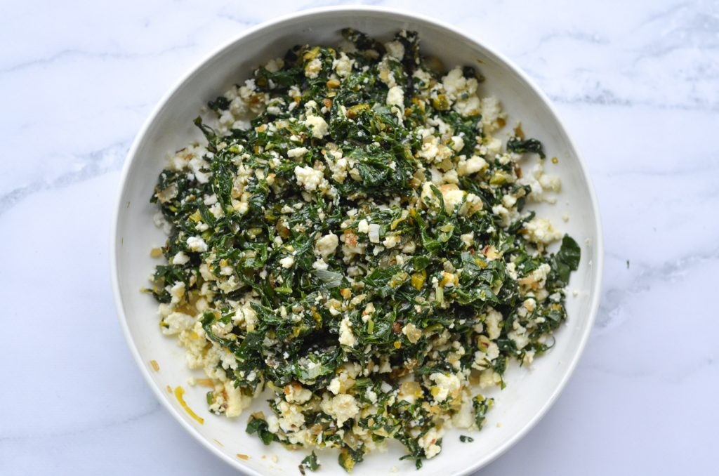 leek and spinach pie mixture in a bowl