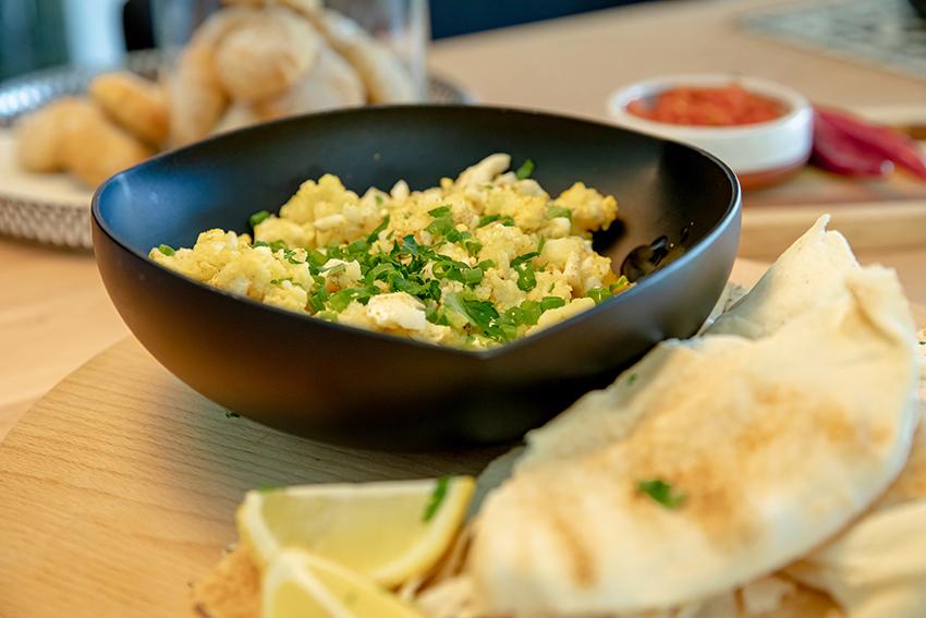 egg and potato served in black bowl
