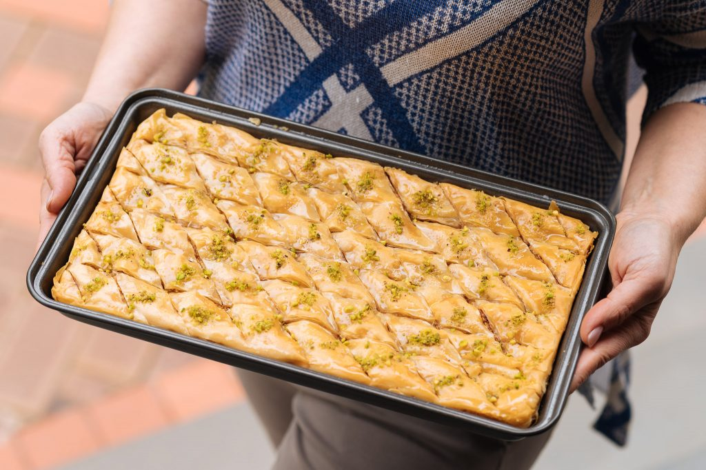 baklawa tray held by hand