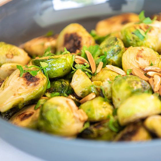 brussel sprouts garnished with parsley and slivered almonds