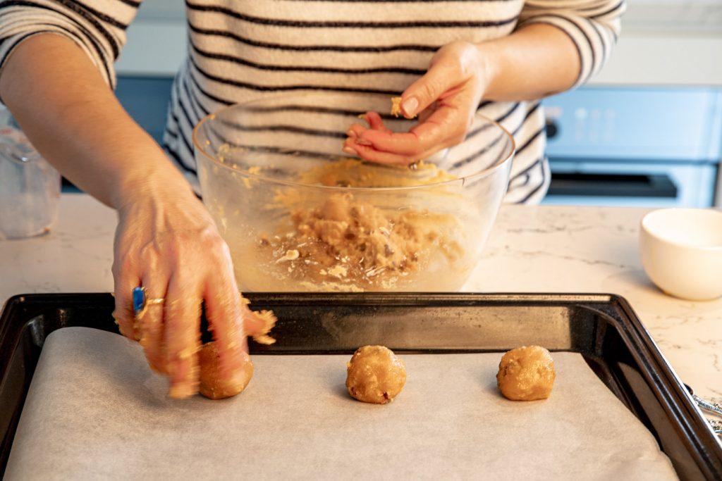 Dividing the mixture into walnut-sized balls