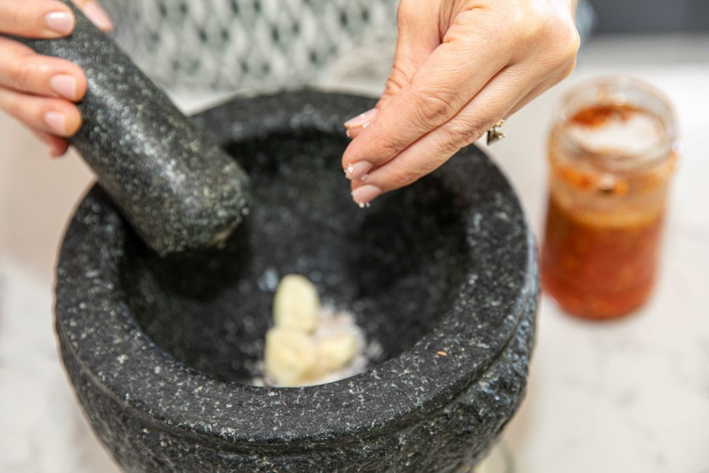 garlic with salt in a mortar and pestl