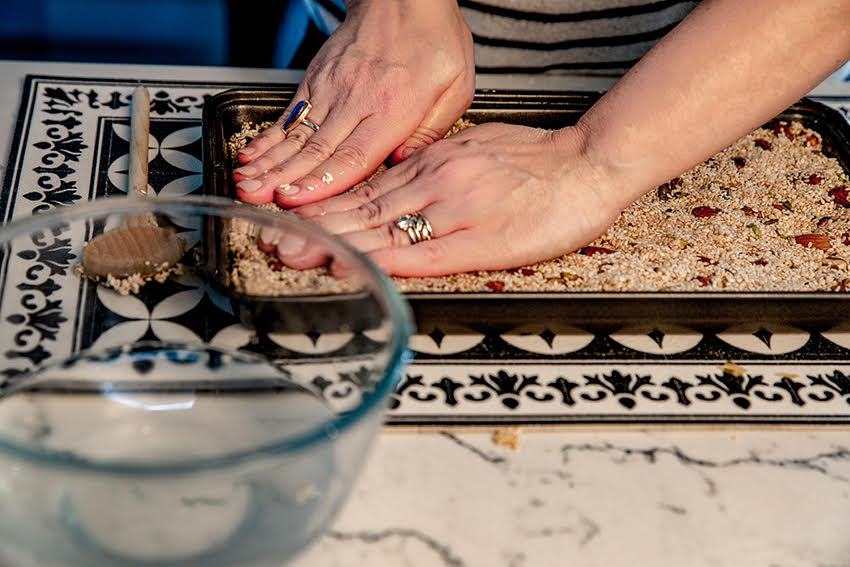 pressing down the sesame slice with wet hands