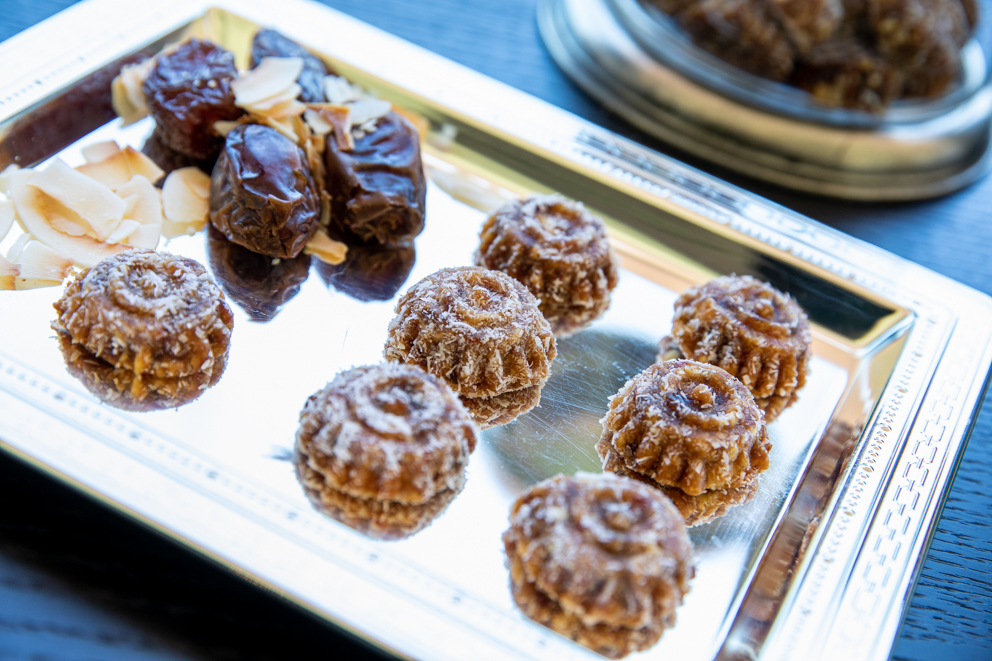 crunchy date treats on a silver tray